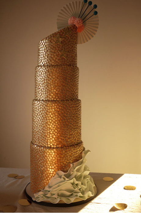 Tall Gold-Speckled Cake with Flower