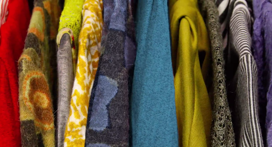 Colorful Coats Hanging in a Closet