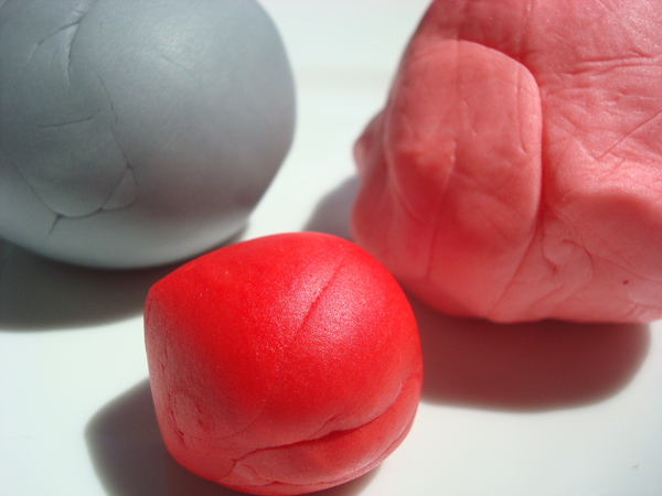 Pieces of Grey, Red and Pink Fondant