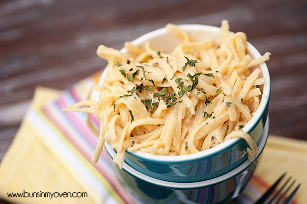Blue Bowl Filled with Alfredo Pasta, On Yellow Plate
