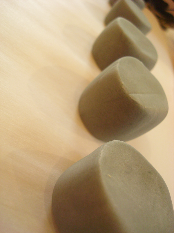Cut and Rounded Pieces of Grey Fondant