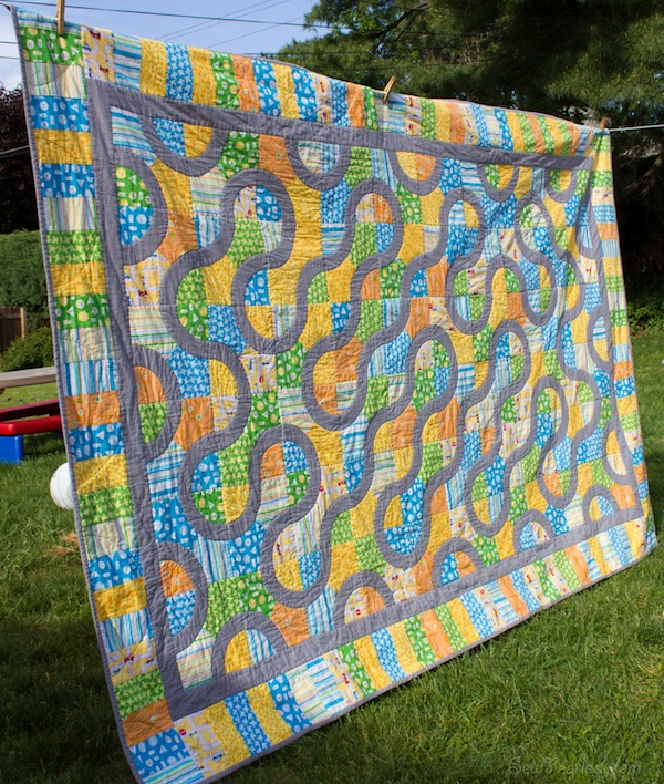 Quilt with Curve Design Hanging on Clothesline