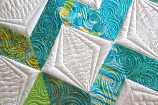 White Quilt with Teal Zigzag Design