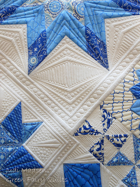 White Quilt with Blue Patterned Stars
