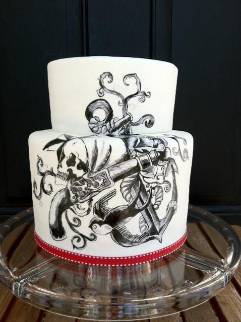 White Cake Adorned with Intricate Black Painting of Pirate Accoutrements