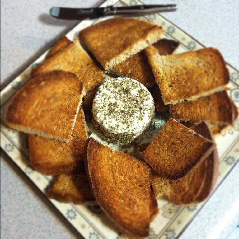Pieces of Bread Around Herb-Crusted Goat Cheese