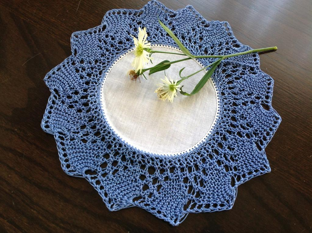 Knitted Blue and White Doily with Flowers on It