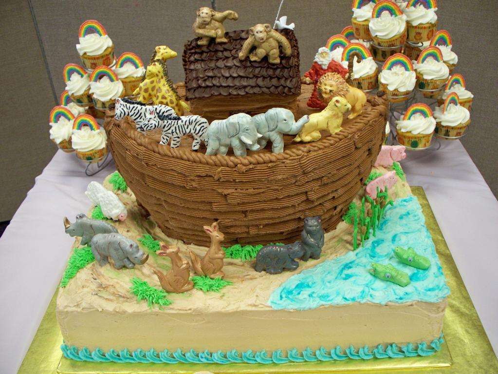 Cake in Shape of Noah's Ark with Accompanying Cupcakes