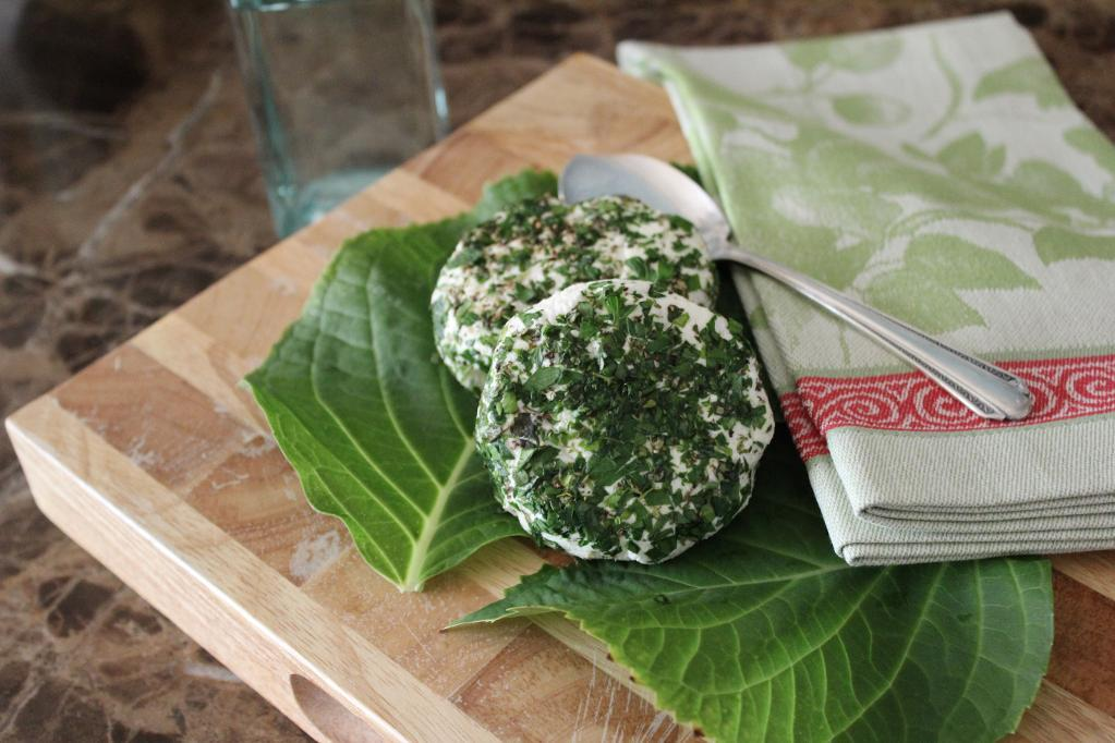 Herb Crusted Goat Cheese on Board with Fresh Herbs and Napkin