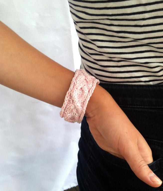 Woman Wearing Pink Knit Bracelet