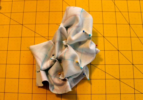 Piece of Fabric Furrowed and Pinned on Measuring Table