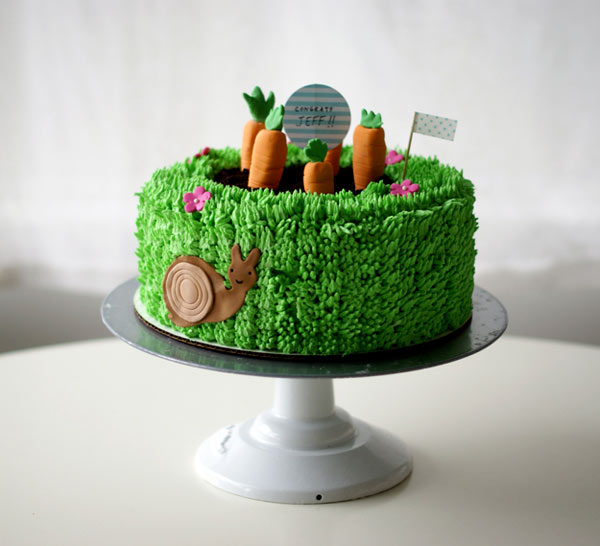 Photo of Cake Decorated with Piped Grass and Fondant Carrots