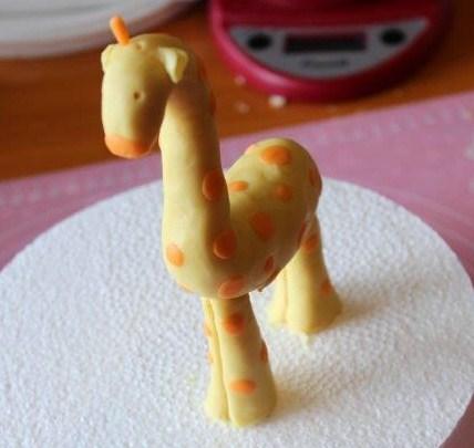 Giraffe Covered in Small Orange spots