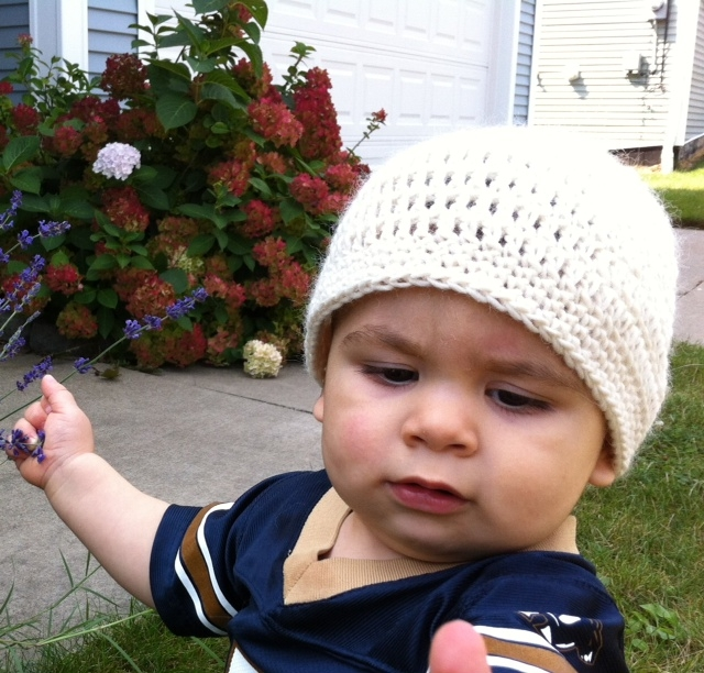 Toddler Wearing White Crocheted Hat