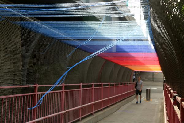 Pedestrian Bridge with Multicolored Yarn Overhanging