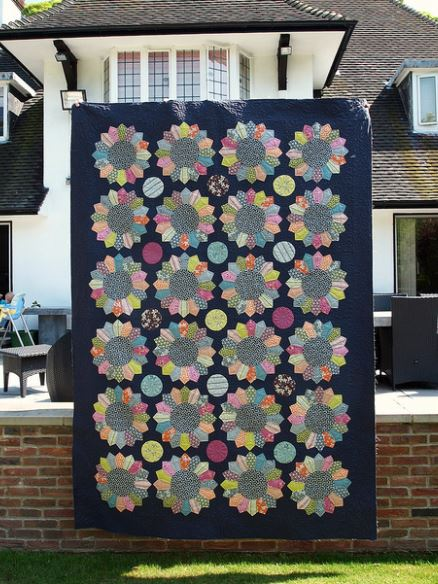 Large Dresden Plate Quilt Hanging Outside of House