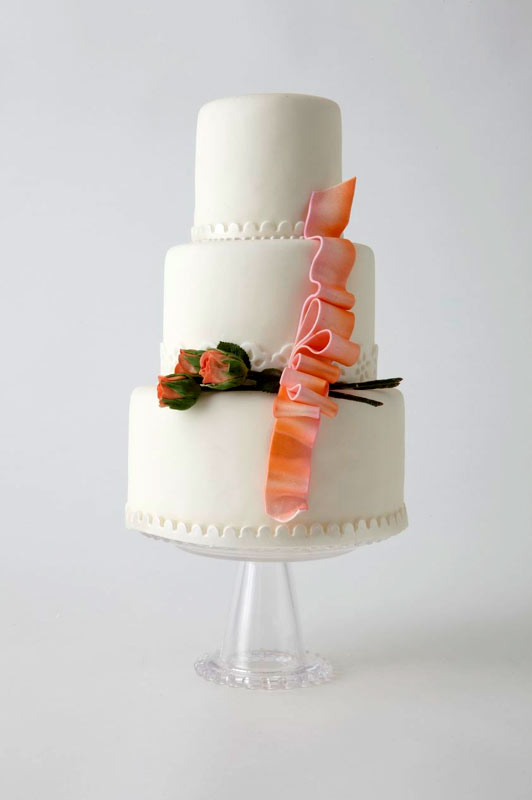 White Tiered Cake with Orange Roses and Ribbon