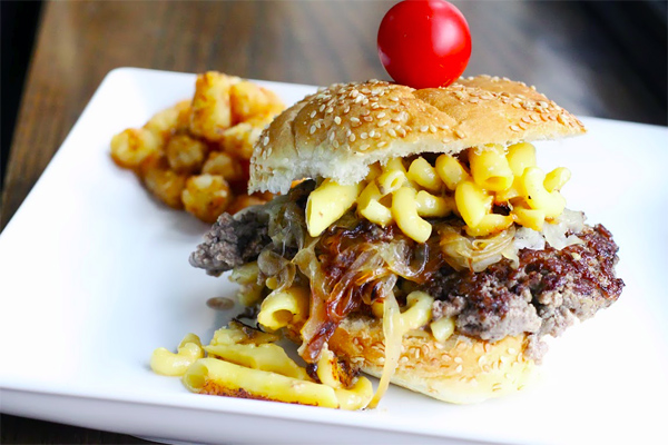 Burger Topped with Mac and Cheese, Cherry Tomato on Top