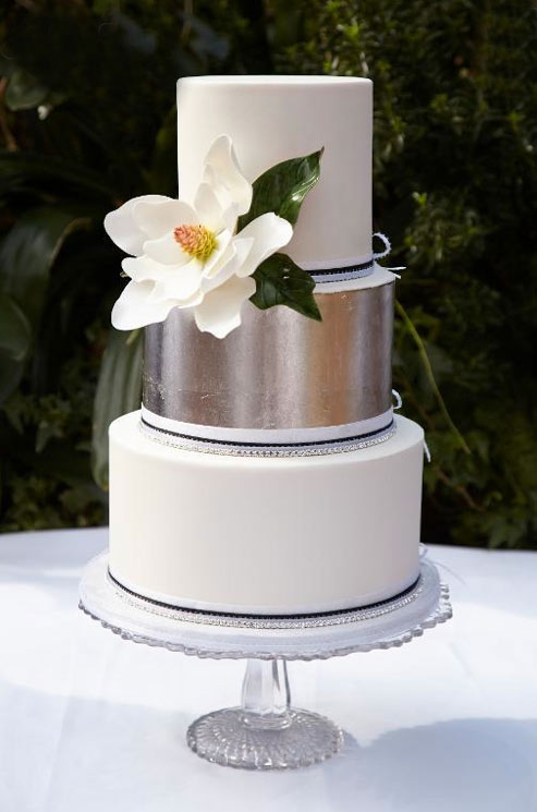 White Tiered Cake with Silver Accent and White Flower