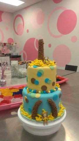 Tiered Cake with Palm Tree Trunk on Top