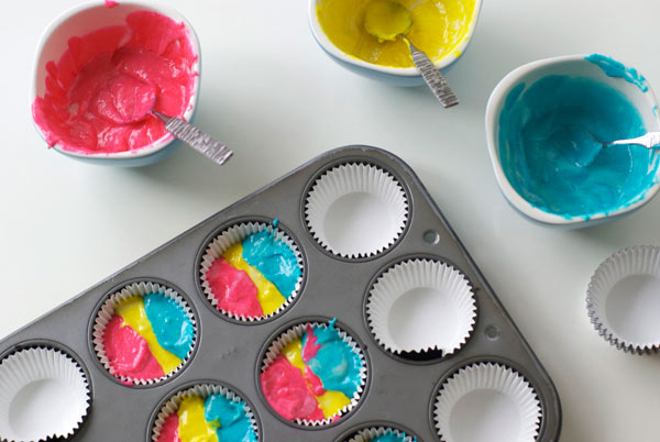 Top View of Vibrant Batter in Cupcake Tins, Batter in Bowls