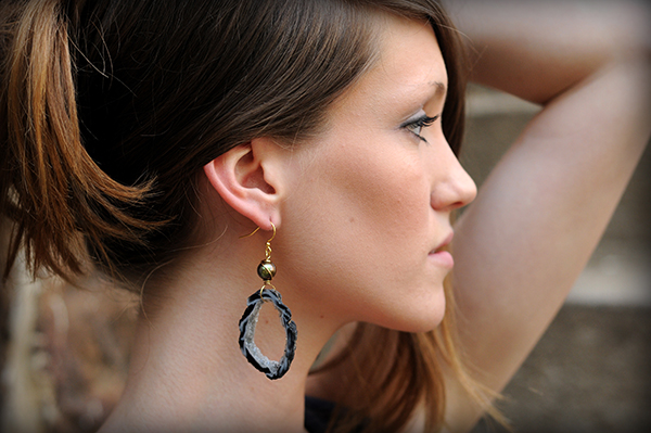 Profile of Woman Holding Her Hair Up