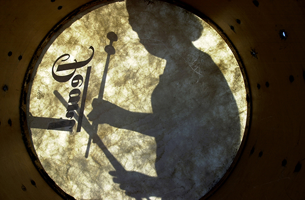 Silhouette of Drummer Through the Skin of a Drum