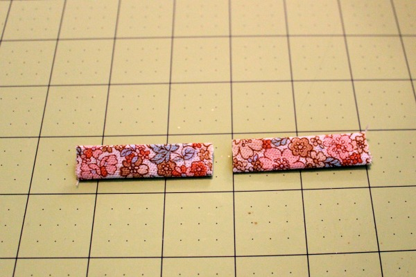 Two Floral Pattered Zipper Tabs