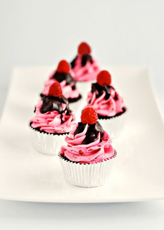 Raspberry Cupcake with Pink Icing, Chocolate Sauce and Raspberry Toppers