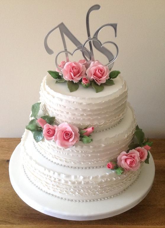 Layered Wedding Cake with Ruffles & Pink Roses