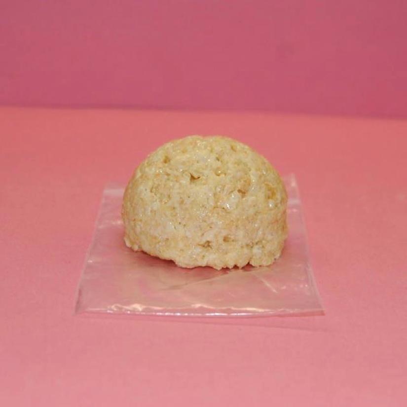 Scoop of Rice Krispies on Piece of Plastic