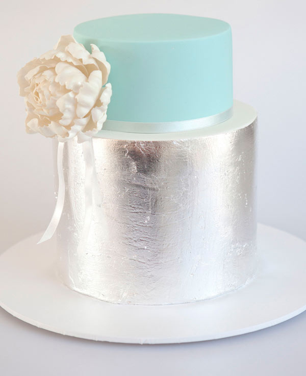 Two-Tiered Cake with Shiny Silver Bottom and Blue Top