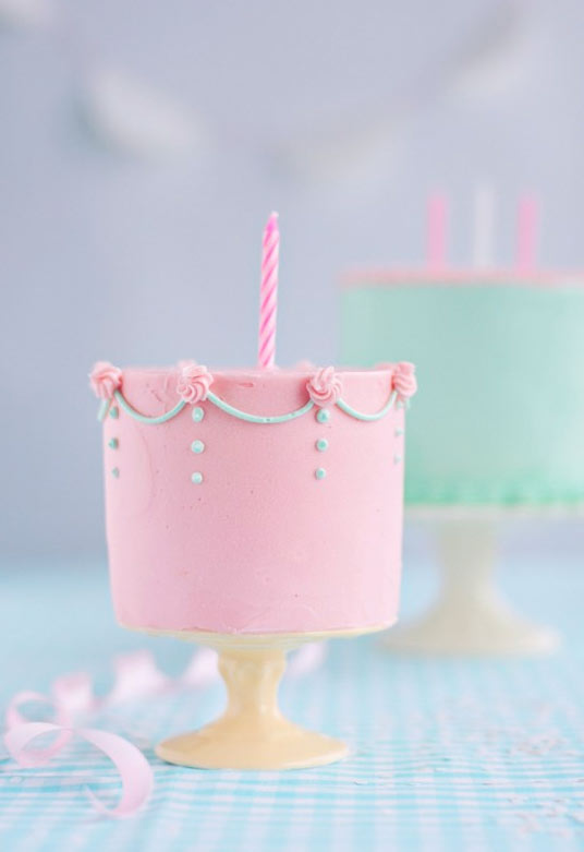 Small Pink Cake with Roses and Single Pink Candle