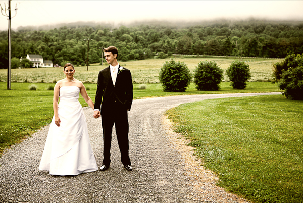 Bride and Groom Standing on Dirt Road in Foggy Atmosphere