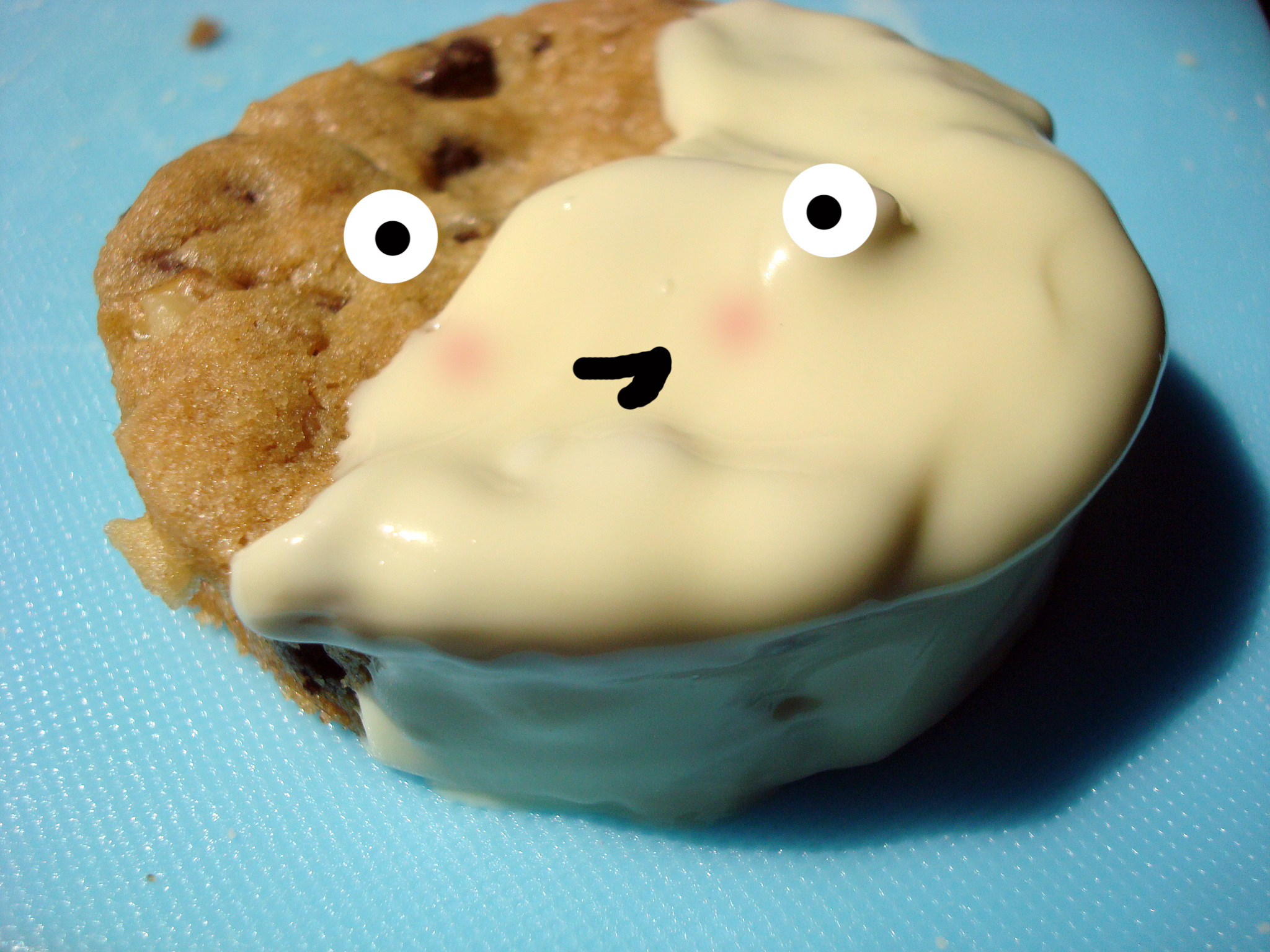 Chocolate Chip Cookie Covered in White Chocolate with Cartoon Face