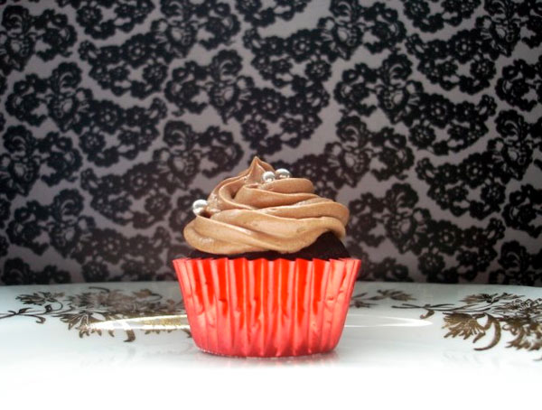Close Up Photo of Cupcake with Chocolate Frosting