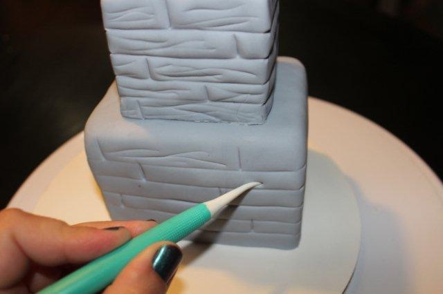 Adding Wood Texture to Cake for Haunted House Cake