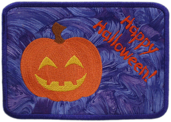 "Embroidered Patch Featuring Pumpkin and ""Happy Halloween!"" Text"