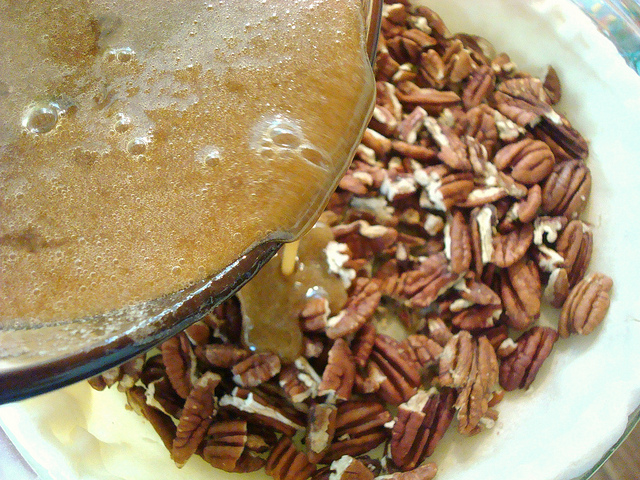 Pouring Mixture onto Pecans in Crust