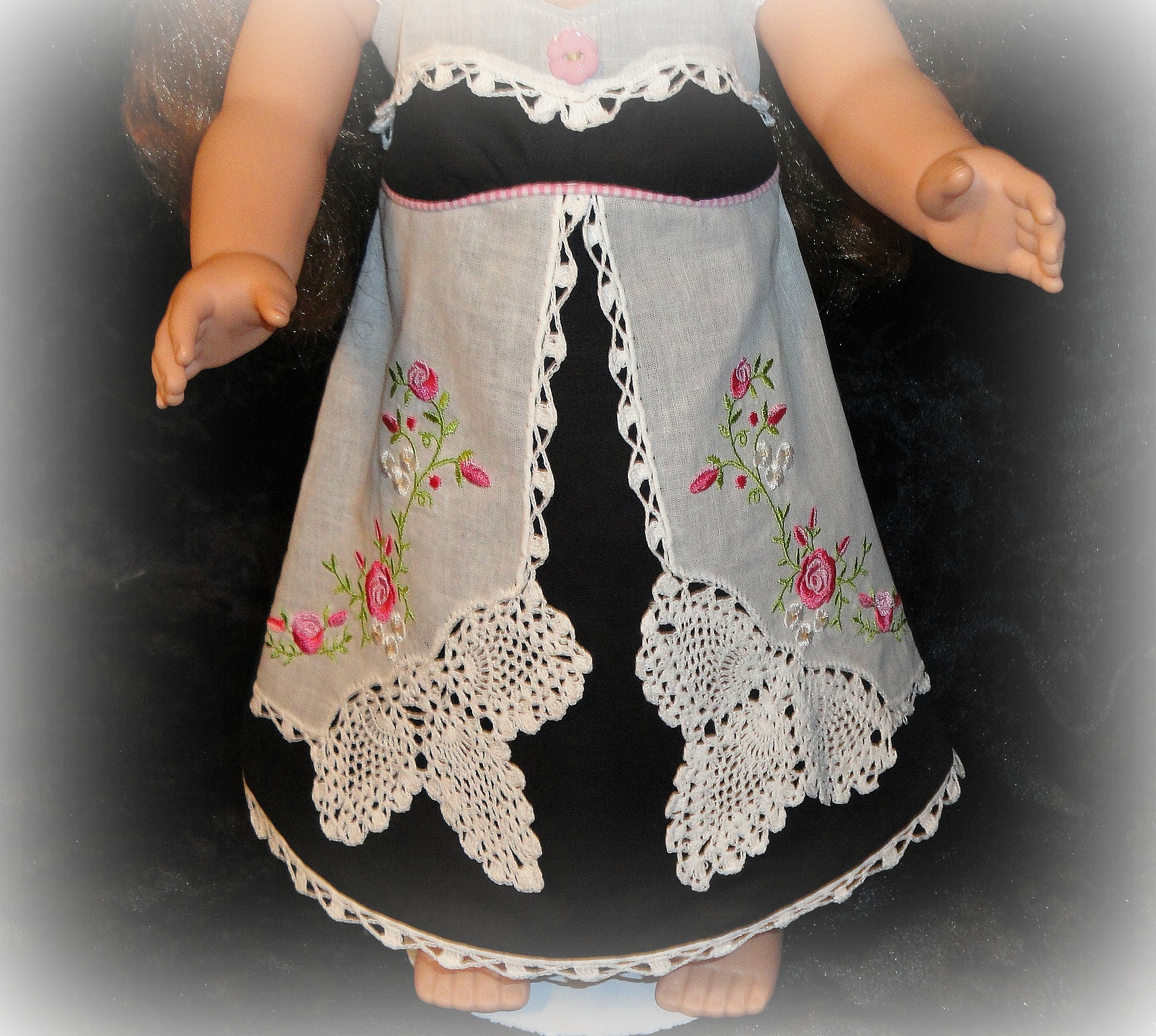 Close up on Embroidered Handkerchief Doll Apron
