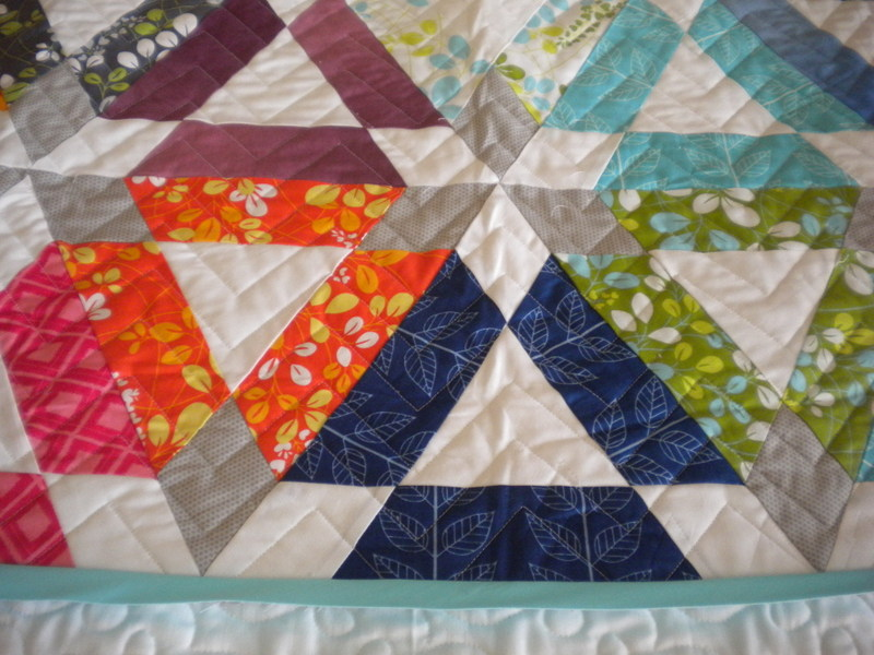 Quilt with Patterned Triangle Design