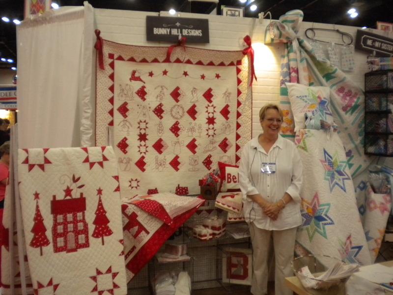 Anne Sutton Posing with Winter Wonderland Quilts