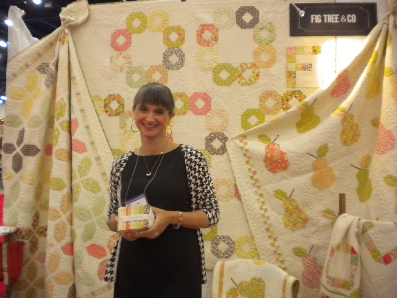 Bluprint instructor Joanna Figueroa posing in font of Fig & Tree Booth