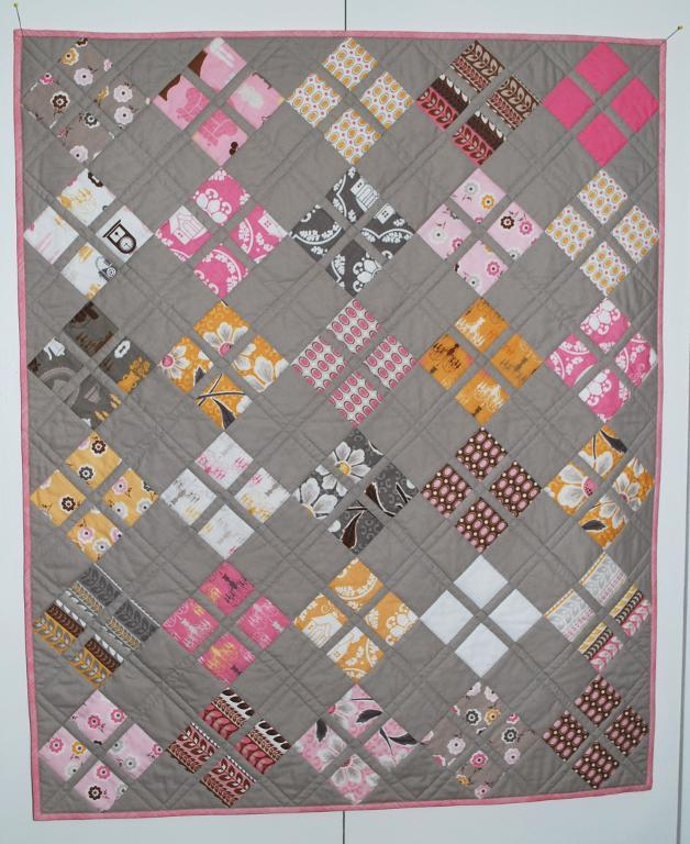 Grey Quilt with Various Patterned Blocks
