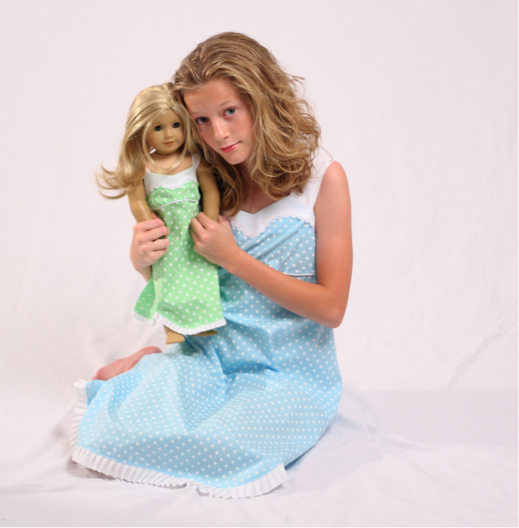 Young Girl with Doll, Wearing Matching Outfits