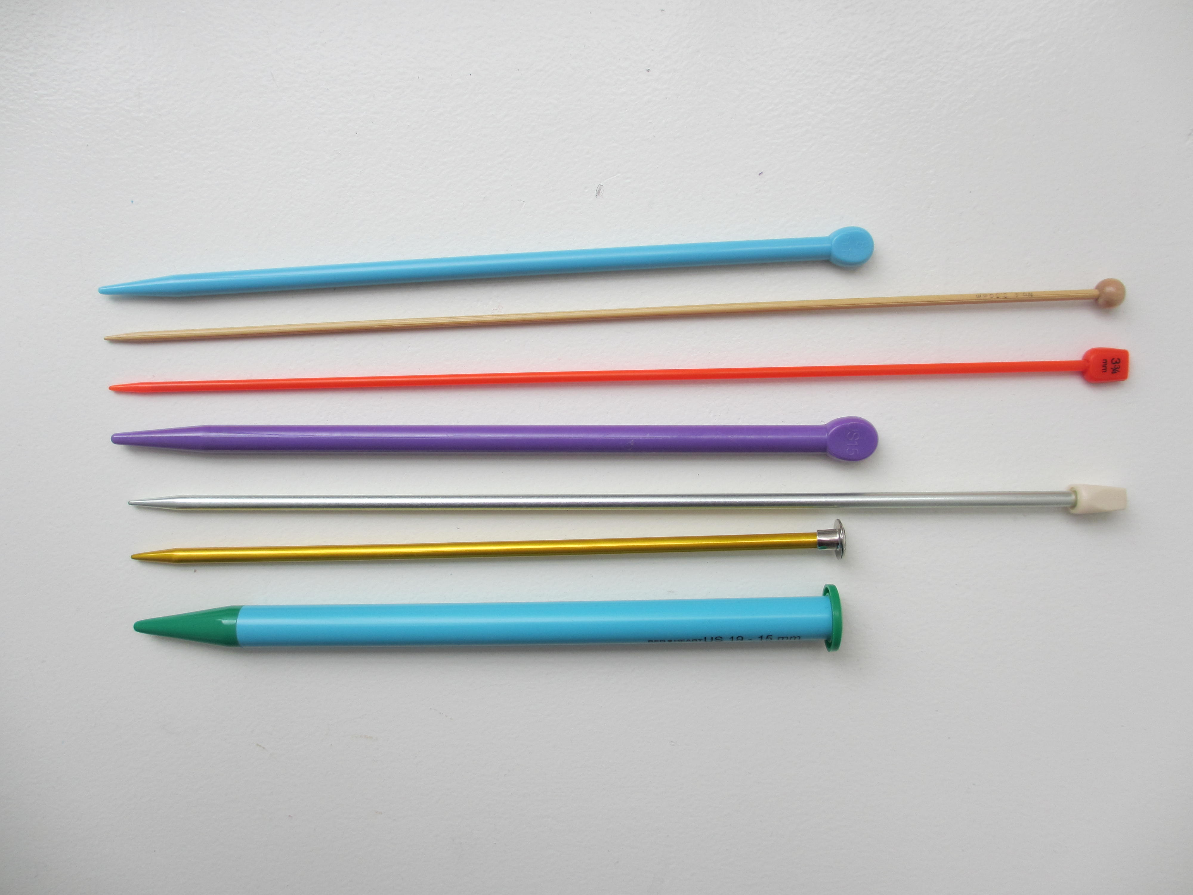 Various Colored Knitting Needles