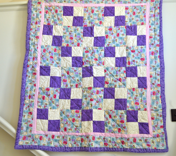 Quilt Featuring Purple, White and Patterned Blocks