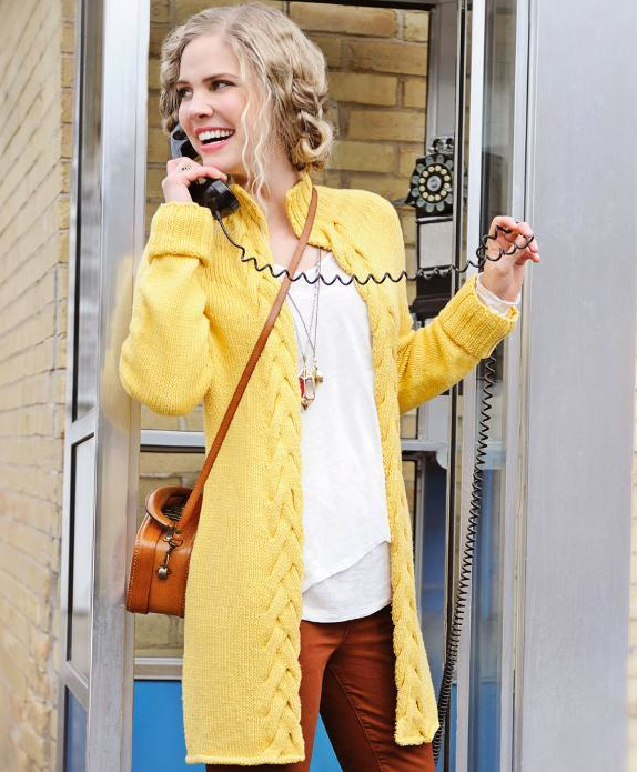 Woman in a Yellow Cardigan in a Phone Booth