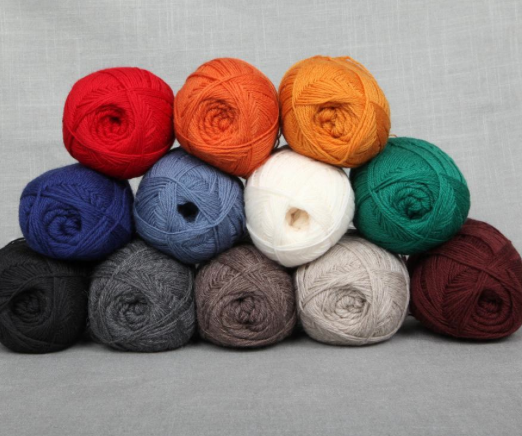 Stack of Different Colored Lamb's Pride Yarn