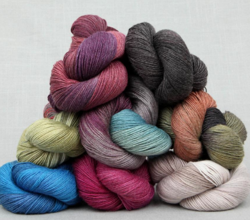 Stack of Lorna Lace Soulmate Yarn